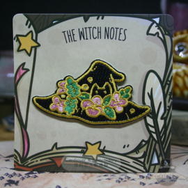 Embroided clothing patch of a witches hat with flowers