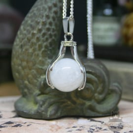 Spiritual necklace of two hands holding an orb of Rock Crystal