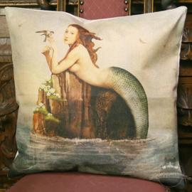 Mermaid laying on a rock with small bird pillowcase