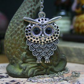 Owl necklace with dark eyes silver colored