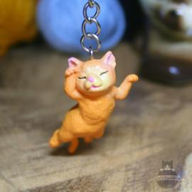 Schlüsselanhänger Kätzchen liegend gestreckt
