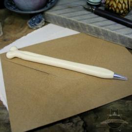 Ballpoint pen in the shape of a bone