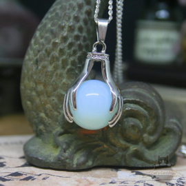 Spiritual necklace of two hands holding an Opal sphere
