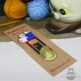 Enameled bookmarker of a reading white cat
