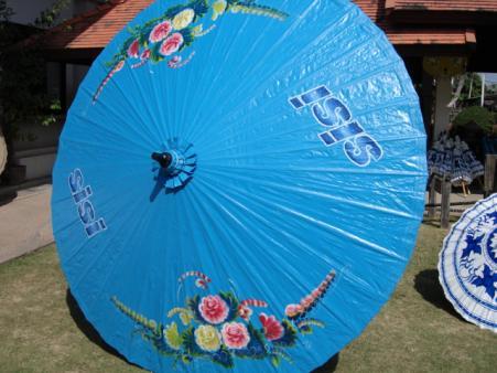 oosterse parasol met sponsor logo