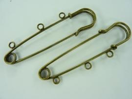CH.485- 2 stuks kiltspelden van 7cm breed met 3 ogen geelbrons