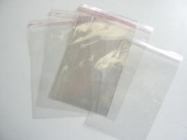 Z.008- ca. 500 stuks cellofaan zakjes met kleefrand 12x18.5 cm glanzend
