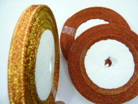 rol met 22.86 meter sparkle lint oranje/brons van 6mm breed OPRUIMING