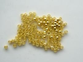 ca. 110 stuks knijpkralen van 2.5mm goudkleur