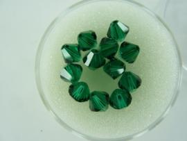 2207 849- 12 stuks swarovski kralen toupille emerald 6mm in een doosje OPRUIMING