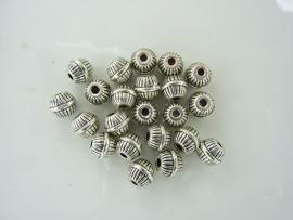 CH.154- 20 stuks zwaar metalen kralen 6x7mm