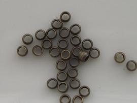 60 stuks knijpkralen 2 mm GEEL/BRONS