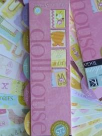5735- 18 velletjes van 24x5cm met kleine diverse stickers K&Co OPRUIMING