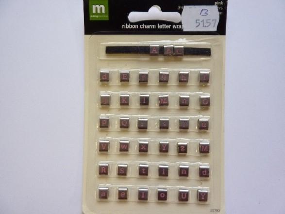 005157.B- 39 stuks lintschuif roze/zilver 5+7mm OPRUIMING