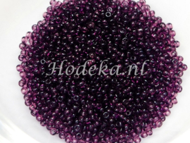 CRP15/19  12 gram Preciosa Rocailles 15/0 Donker Paars transparant