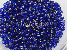 CRP08/56  12 gram Preciosa Rocailles 8/0 Donker Blauw silverlined