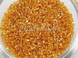 CRP11/43  12 gram Preciosa Rocailles 11/0 Goud silverlined