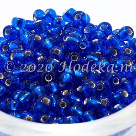 CRP06/65a  50 gram Preciosa Rocailles 6/0  Blauw silverlined