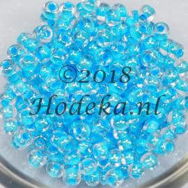 CRP06/47  12 gram Preciosa Rocailles 6/0  transparant blauwe kern