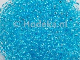 CRP08/16a  50 gram Preciosa Rocailles 8/0 Blauw transparant