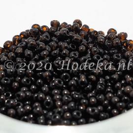 CRP10/86a  50 gram Preciosa Rocailles 10/0 Donker bruin transparant
