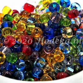 CRP06/67a  50 gram Preciosa Rocailles 6/0 Kleuren mix transparant