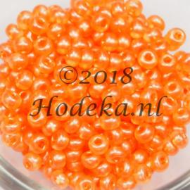 CRP06/56  12 gram Preciosa Rocailles 6/0  Transparant mat oranje