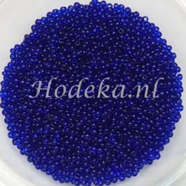 CRP15/27  12 gram Preciosa Rocailles 15/0 Heel Donker Blauw Transparant