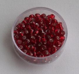 CNR06/07   Rocailles 50 gr.  Rood/Oranje met een Zilveren kern 6/0