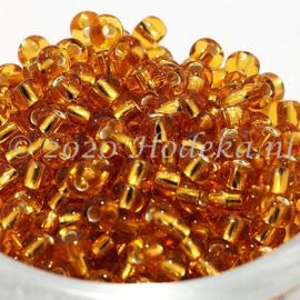 CRP06/64  12 gram Preciosa Rocailles 6/0  Goud silverlined