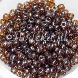 CNR06/05   Rocailles 50 gr.  bruin Transparant 6/0