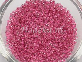 CRP10/61a  50 gram Preciosa Rocailles 10/0 Transparant roze kern