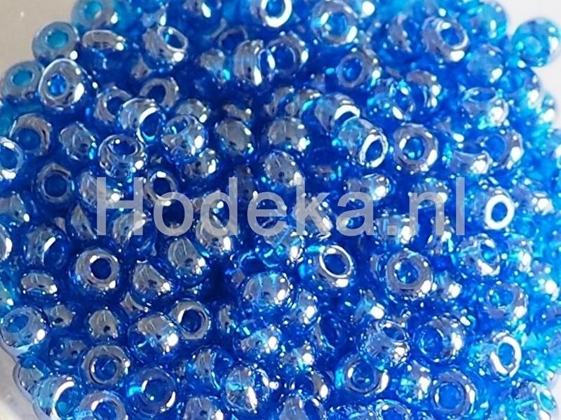 Opruiming van de CRP07/04a  50 gram Preciosa Rocailles 07/0 Blauw Transparant