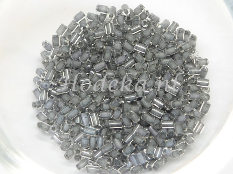 Opruiming van de CZT06  Rocailles staafje 10 gr. Transparant Grijze kern ca. 2 mm