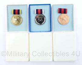 DDR Feuerwehr fur treue dienste medaille 3 delige set goud zilver brons met doosjes - Origineel