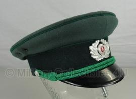 DDR pet VoPo (Volkspolizei) - groen - 52, 55, 56 of 57 cm - origineel