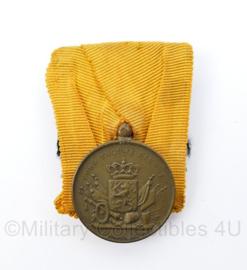 Defensie trouwe dienst voor 12 jaar trouwe dienst medaille uit periode  Koningin Juliana - origineel