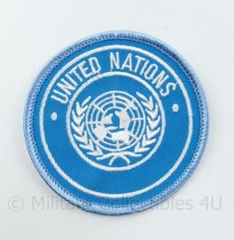 United Nations embleem felblauw - diameter 7,5 cm - origineel