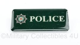 Britse Politie uniform borst naamplaatje POLICE - Police Security Northern Ireland - 7,5 x 3,5 cm - origineel