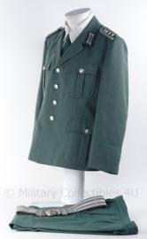 """Duits DDR """"VOPO Volkspolizei"""" met jas, broek, das en Parade koppel - maat K52 - origineel"""