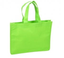 Non Woven draagtas lus handgreep formaat 35+8x25cm, groen, verpakt per 100 stuks