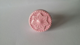 roze kast- of deurknopje met ster.