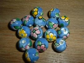 Mooie blauwe kralen met bloem 12 mm.