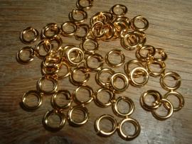 Mooie DQ metalen goudkleurige ringetjes van 6 mm.