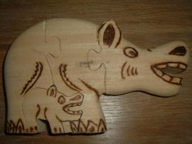 Mooie handgemaakte blank houten puzzle van een nijlpaard uit Burkina Faso