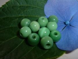 5 Stuks mooie groene cateyekralen van 7 mm.