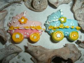 Roze en blauwe kinderwagens/wiegjes