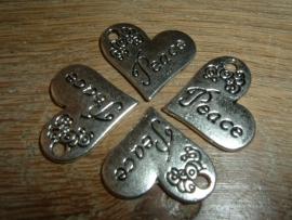 """Mooie zilverkleurige hangertjes met de tekst """"Peace"""""""