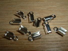 10 zilverkleurige veterklemmetjes 10x4mm.
