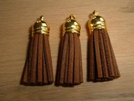Mooie bruine kwastjes met goudkleurig kapje